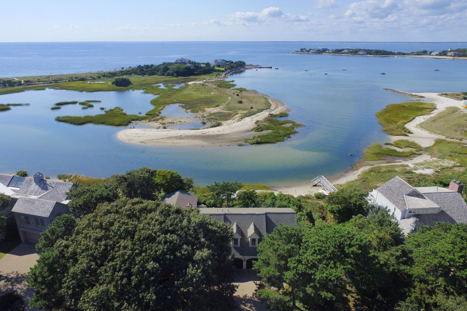 Aerial photograph of homes on the water in Falmouth, MA